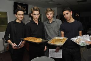 LPSB 6th Formers serve patrons with Harrington's Kitchen's delicious complimentary focaccia (Nov. '12).